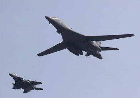 U.S. B-1B Lancer bomber fly over Osan Air Base with South Korean Air forces F-15K Fighting Falcon in Pyeongtaek, South Korea, Tuesday, Sept. 13, 2016