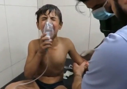 A still image taken on September 7, 2016 from a video posted on social media said to be shot in Aleppo's Al Sukari on September 6, 2016, shows a boy breathing with an oxygen mask inside a hospital, after a suspected chlorine gas attack