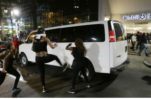 Demonstrators protest Tuesday's fatal police shooting of Keith Lamont Scott in Charlotte, N.C. on Wednesday, Sept. 21, 2016 / AP