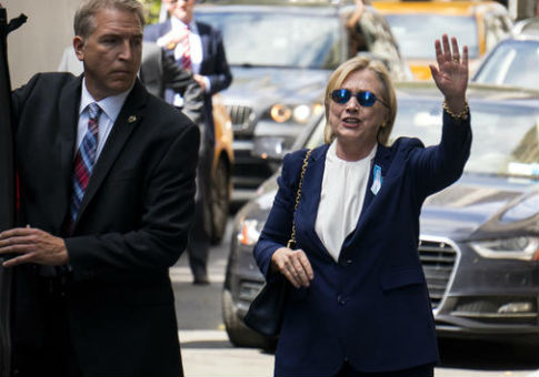 Hillary Clinton walks from her daughter's apartment building Sept. 11, 2016, in New York / AP