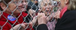 Hillary Clinton greets supporters on the other side of a fence in 2008 / AP