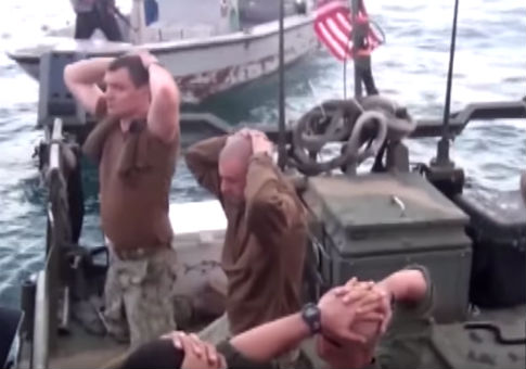 U.S. Navy sailors kneel as they are detained by the Iranian Revolutionary Guards