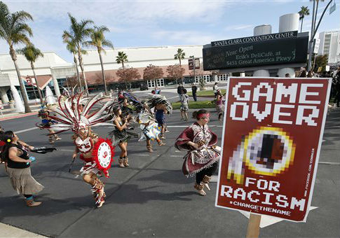 A group protests the Washington Redskins name / AP