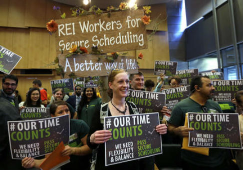 Activists rally for scheduling rules before a Seattle City Council meeting / AP