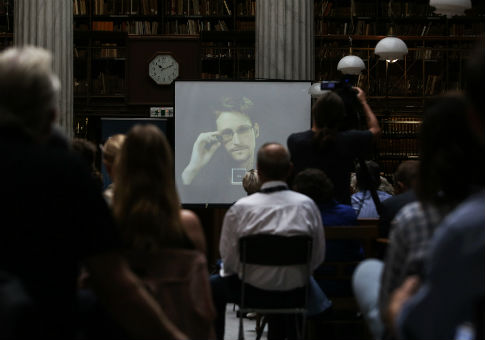 NSA leaker Edward Snowden speaks via video link  / AP