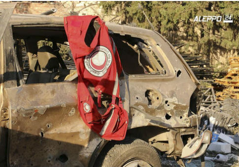 A vest of the Syrian Arab Red Crescent hanging on a damaged vehicle, in Aleppo, Syria, Tuesday, Sept. 20, 2016 / Aleppo 24 news via AP