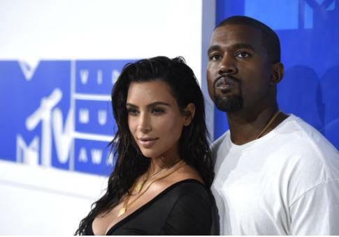 Kim Kardashian and Kanye West / AP