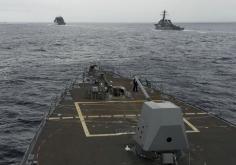 U.S. Navy destroyers conduct a freedom of navigation operation in the South China Sea / AP
