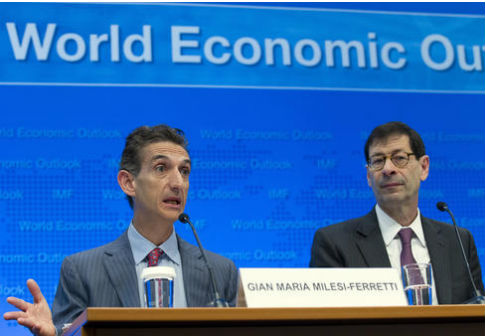 IMF Deputy Director, Research Dept Gian Maria Milesi-Ferretti, left, accompanied by IMF Economic Counsellor Maurice Obstfeld / AP