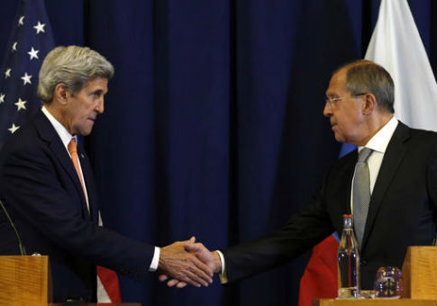 Secretary of State John Kerry, left, and Russian Foreign Minister Sergei Lavrov shakes hands / AP