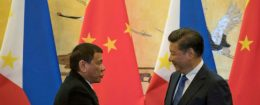 Philippine President Rodrigo Duterte (L) and Chinese President Xi Jinping shake hands / REUTERS