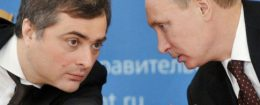 Russian leader Vladimir Putin, right, speaks to aide Vladislav Surkov / AP
