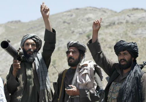 Taliban fighters react to a speech in the Shindand district of Herat province, Afghanistan / AP