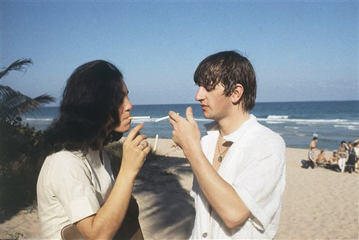 Ringo Starr of the Beatles gives an unidentified person a light at the beach in Miami, Florida in February 1964. (AP Photo)