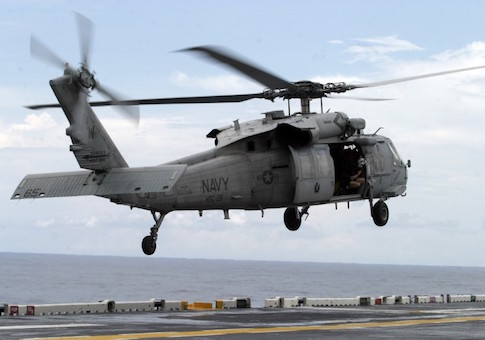 U.S.Navy MH-60 Night Hawk helicopter prepares to land on the deck of the USS Kearsarge ship