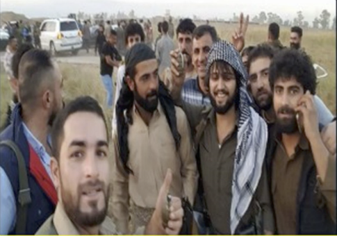 Ako Abdulrahman, center, saved dozens in Iraq with armored BMW / Screenshot from YouTube