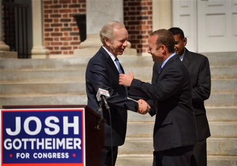 N.J. congressional candidate Josh Gottheimer, a Democrat, shakes hands with former Connecticut Sen. Joe Lieberman / AP