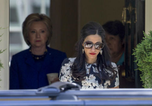 Huma Abedin, right, followed by Hillary Clinton / AP