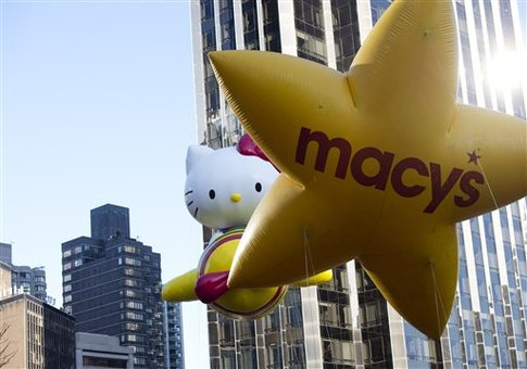The Hello Kitty balloon floats in the Macy's Thanksgiving Day Parade in 2012 / AP