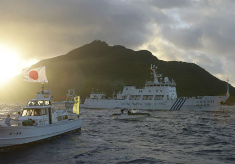 A Chinese surveillance ship, right, sails near the biggest island in the disputed Senkaku Islands in 2013 / AP