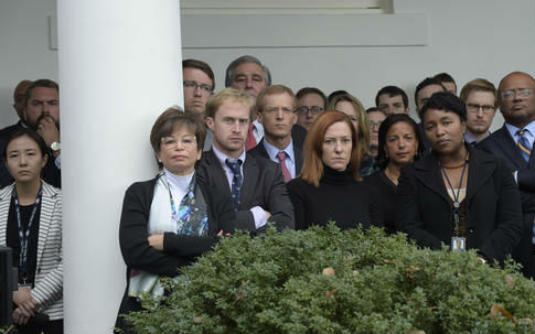 Staff listen as President Obama speaks about the election results / AP