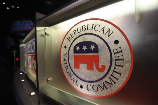 The Republican National Committee logo is shown on the stage as crew members work at the North Charleston Coliseum, Wednesday, Jan. 13, 2016, in North Charleston, S.C., in advance of Thursday's Fox Business Network Republican presidential debate. (AP Photo/Rainier Ehrhardt)