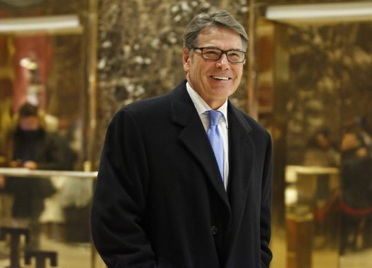 Former Texas Gov. Rick Perry smiles as he leaves Trump Tower, Monday, Dec. 12, 2016, in New York. (AP Photo/Kathy Willens)