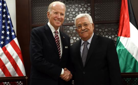 Joe Biden (left) shaking hands with Palestinian President Mahmoud Abbas in March (AP)