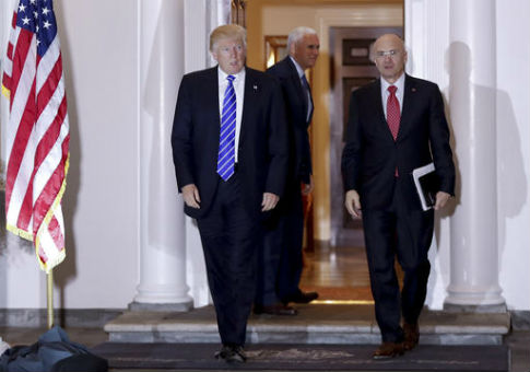 Donald Trump walks with CKE Restaurants CEO Andy Puzder / AP