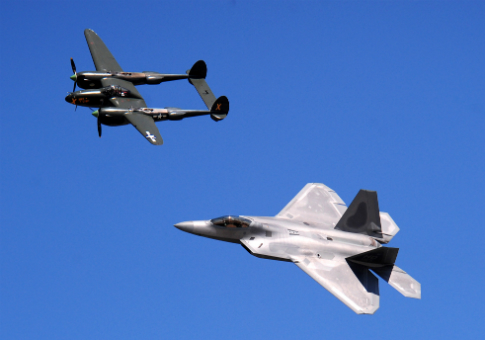 A P-38 Lightning and F-22 Raptor / USAF photo by Josh Plueger