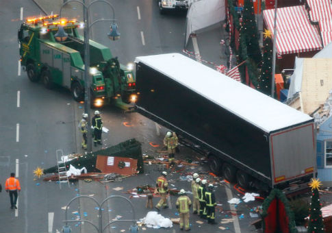 Rescue workers tow truck which ploughed into crowded Christmas market in Berlin, Germany, Dec. 20, 2016 / REUTERS