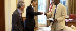 President Barack Obama gives a fist-bump to Personal Aide Reggie Love
