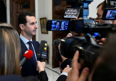 Syria's President Bashar al-Assad speaks to French journalists in Damascus, Syria / REUTERS