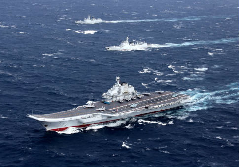 China's Liaoning aircraft carrier with accompanying fleet conducts drill in South China Sea / REUTERS