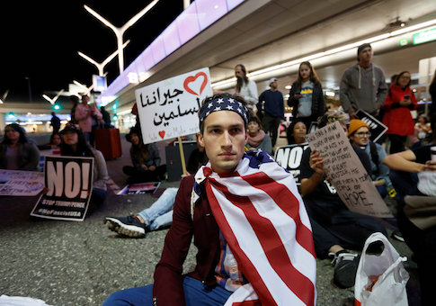 Demonstrators shut down the traffic loops at LAX International Airport and yell slogans during a protest against the travel ban imposed by U.S. President Donald Trump's executive order, at Los Angeles International Airport in Los Angeles