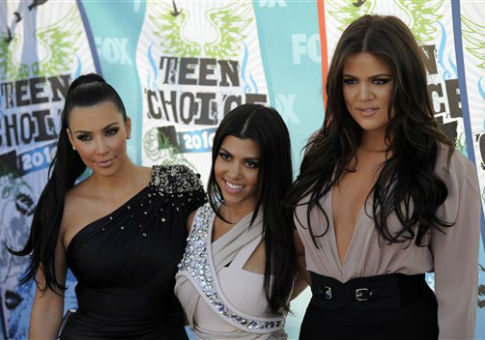 From left, Kim Kardashian, Kourtney Kardashian, and Khloe Kardashian / AP