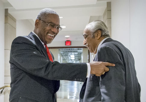 Rep. Gregory Meeks (D., N.Y.), left, smiles as he has a friendly exchange with Rep. Charlie Rangel (D., N.Y.) in 2015 / AP