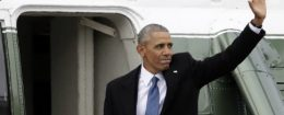 Former President Barack Obama waves goodbye as he boards a Marine helicopter / AP