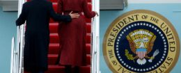 Barack and Michelle Obama board Special Air Mission 28000, a Boeing 747 which serves as Air Force One / REUTERS