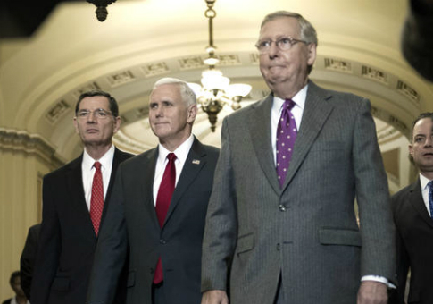 Vice President-elect Mike Pence, flanked by Senate Majority Leader Mitch McConnell and Sen. John Barrasso / AP
