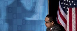 Rep. Keith Ellison (D, Minn._ listens as newly elected DNC Chairman Tom Perez gives a victory speech  / AP