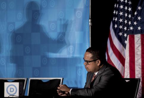 Rep. Keith Ellison (D, Minn._ listens as newly elected DNC Chairman Tom Perez gives a victory speech  / AP