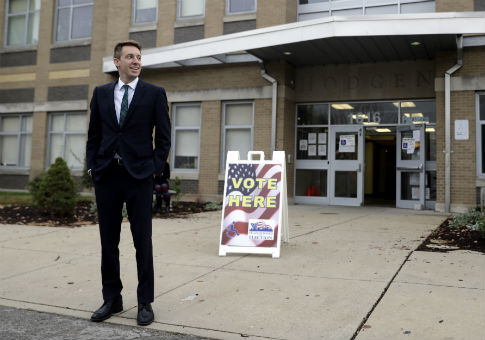 Jason Kander Standing Outside a Polling Place / AP