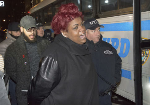 Ashley Sharpton, NAN youth leader, being arrested / AP