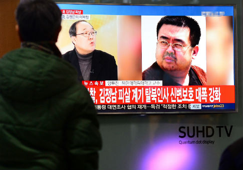 People watch TV screen broadcasting news report on assassination of Kim Jong Nam, older half brother of North Korean leader Kim Jong Un / REUTERS