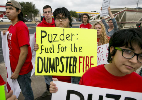 About 20 activists with Fight for $15, protests the nomination of Andy Puzder to lead the Department of Labor / AP