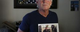 "William Owens holds a photo of his youngest son Navy SEAL William ""Ryan"" Owens, who was killed during an anti-terrorism raid in Yemen / AP"