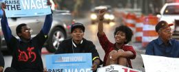 Protesters block traffic as part of national protest to push fast-food chains to pay employees at least $15 an hour / AP