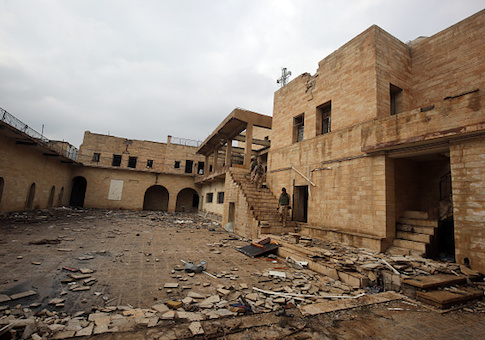 Iraqi soldiers inspect the debris at St. George's Monastery, a historical Chaldean Catholic church on the northern outskirt of Mosul, which was destroyed by ISIS