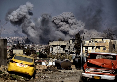 Smoke plumes rise after an airstrike in west Mosul